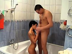 Taking a shower together makes these young sweethearts so