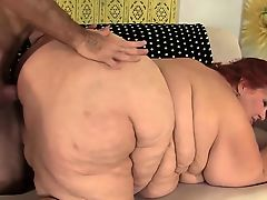Huge BBW Has a Cock Stuffed in Her Cakehole and Cunt