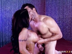 busty brunette gets oiled and banged
