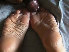 Lyn sucks and takes a load on her soles.