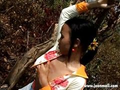 asian babe doing an outdoor solo play