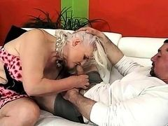 Naughty granny fucks young men on the couch