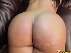 Latina tgirl posing before jumping on cock