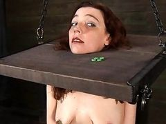 Tough beauty in shackles receives her pussy pumped