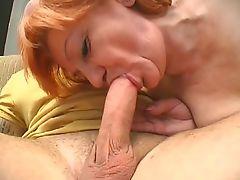 Granny sucks big white cock and pussy fucked on sofa