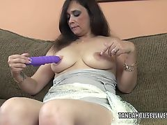 Busty MILF Alesia Pleasure is fucking her purple dildo