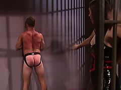 Sexy brunette in latex whipping her guy happily